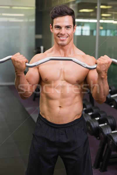 笑みを浮かべて シャツを着ていない 筋肉の 男 バーベル ストックフォト © wavebreak_media