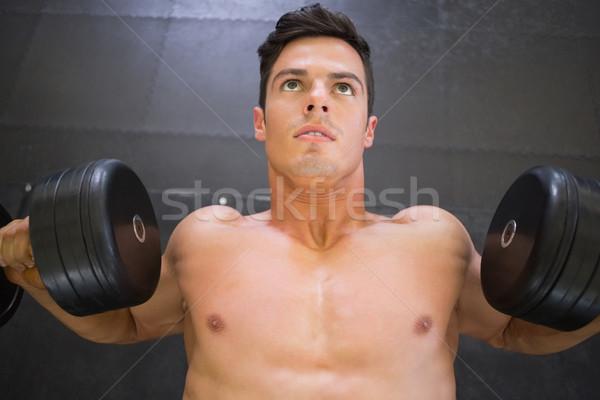 мышечный человека гантели спортзал рубашки Сток-фото © wavebreak_media