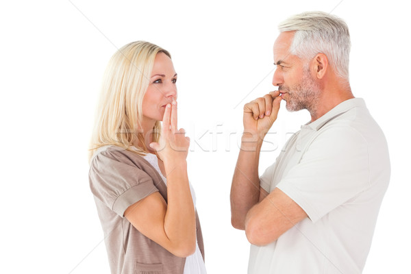 Couple staying silent with fingers on lips Stock photo © wavebreak_media