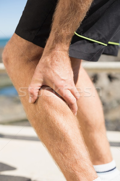 Fit man gripping his injured calf muscle Stock photo © wavebreak_media