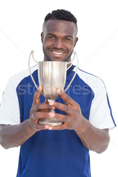Football player holding winners cup Stock photo © wavebreak_media