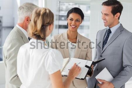 Collega's vergadering kantoor jonge business pak Stockfoto © wavebreak_media