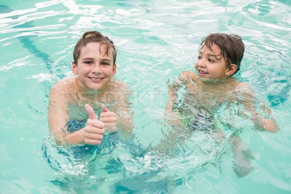 Cute мало дети Бассейн отдыха центр Сток-фото © wavebreak_media