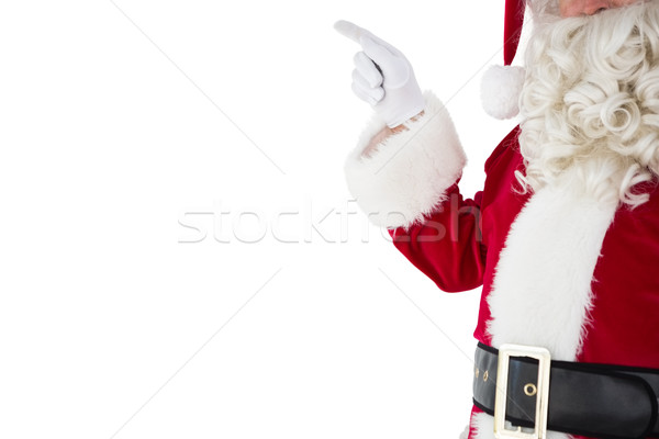 Mid section of santa pointing  Stock photo © wavebreak_media