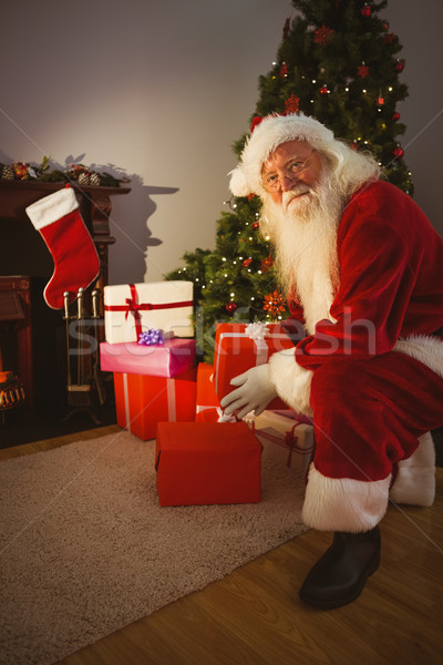 Happy santa delivering gifts at christmas eve Stock photo © wavebreak_media