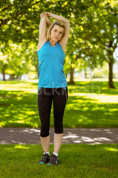 Fit blonde stretching in the park Stock photo © wavebreak_media