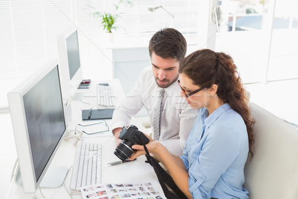 Concentrado cámara digital oficina reunión Foto stock © wavebreak_media