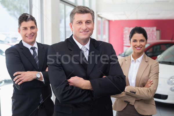 Smiling business team standing with arms crossed Stock photo © wavebreak_media