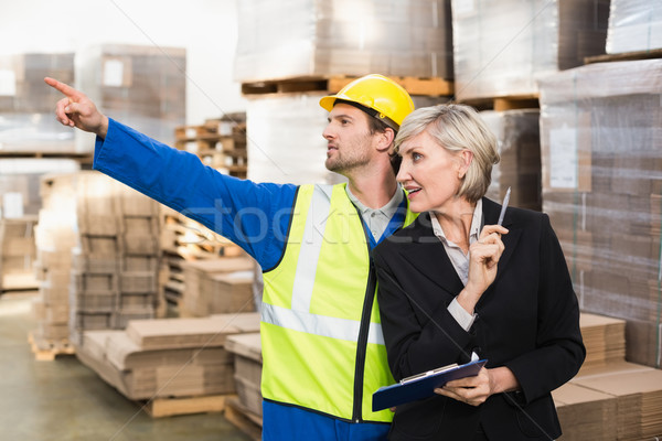 Warehouse worker and his manager working together Stock photo © wavebreak_media