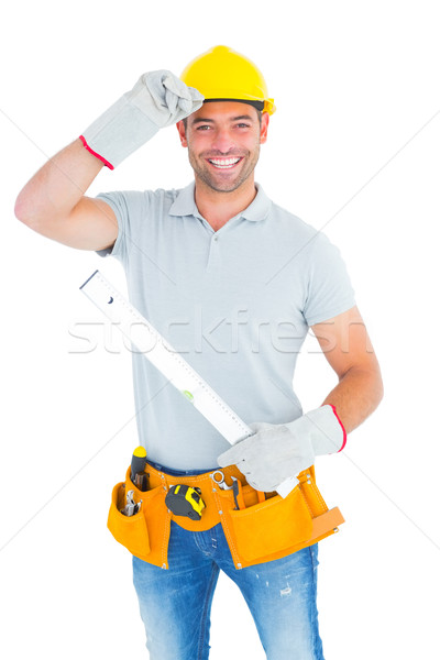 Smiling handyman holding spirit level Stock photo © wavebreak_media