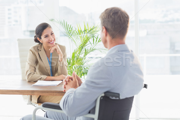 Smiling businesswoman interviewing disabled candidate Stock photo © wavebreak_media