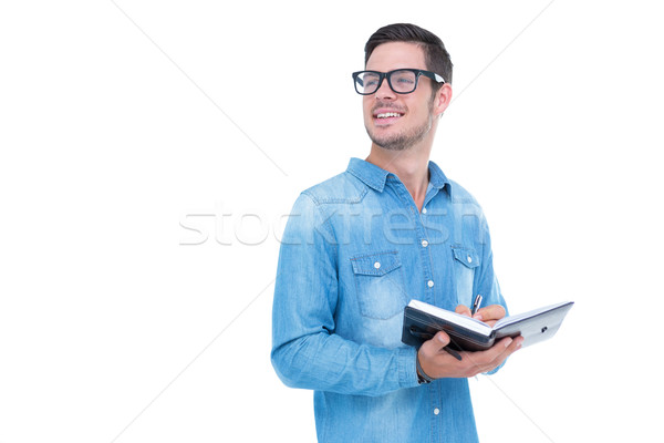 Geeky hipster taking notes in book Stock photo © wavebreak_media