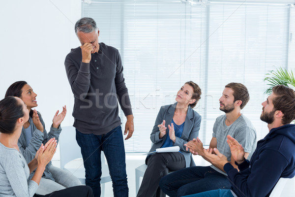 Rehab group applauding delighted man standing up Stock photo © wavebreak_media