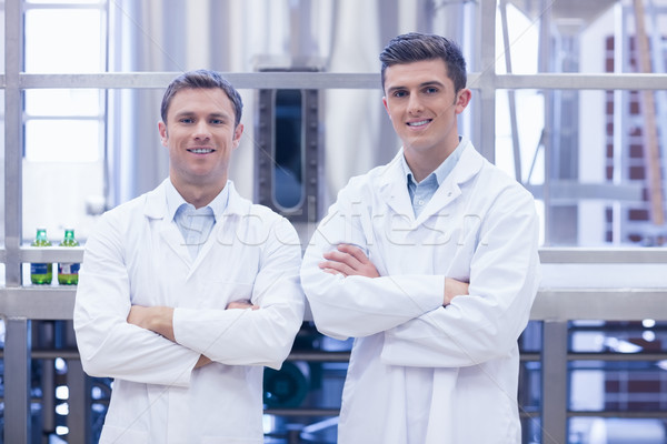 Scientist team smiling at camera with arms crossed Stock photo © wavebreak_media