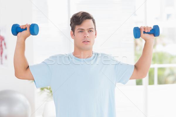 若い男 訓練 ダンベル 医療 オフィス スポーツ ストックフォト © wavebreak_media
