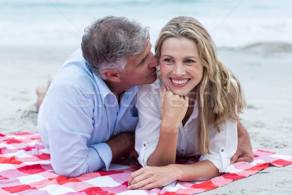 Boldog pár pléd csók tengerpart szeretet Stock fotó © wavebreak_media