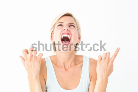 Upset woman screaming with hands up  Stock photo © wavebreak_media