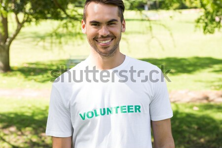Composite image of handsome man pointing to his volunteer tshirt Stock photo © wavebreak_media
