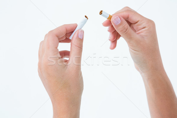 Close up of a woman breaking cigarette Stock photo © wavebreak_media