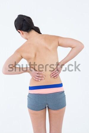 Brunetka dotknąć bolesny powrót biały kobieta Zdjęcia stock © wavebreak_media