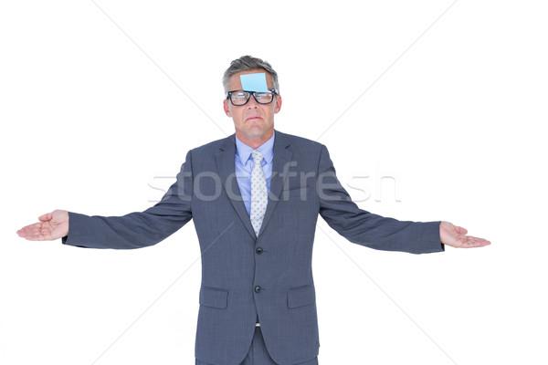 бизнесмен разместить его лице белый рук костюм Сток-фото © wavebreak_media