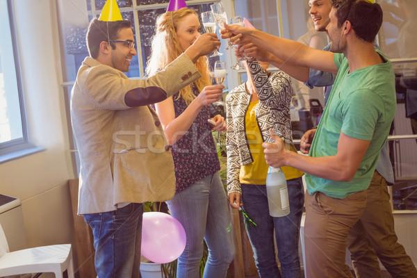 Stock photo: Business people celebrating a birthday
