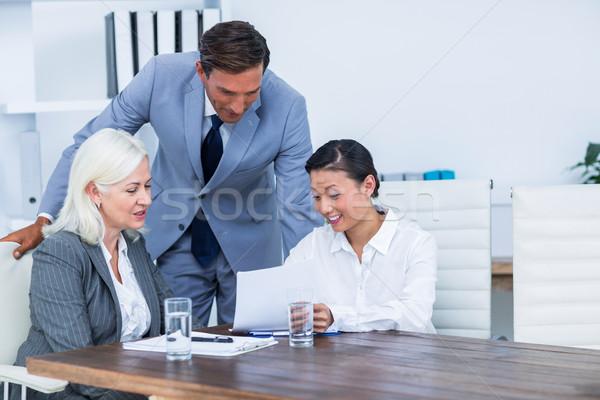 Pessoas de negócios olhando documentos escritório homem reunião Foto stock © wavebreak_media