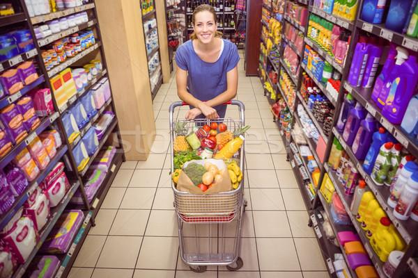 Pretty woman popychanie przejście supermarket kobieta szczęśliwy Zdjęcia stock © wavebreak_media