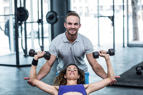 ストックフォト: 筋肉の · 女性 · ダンベル · トレーナー · 支援