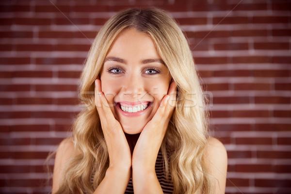 Güzel sarışın kadın memnun portre kırmızı tuğla Stok fotoğraf © wavebreak_media