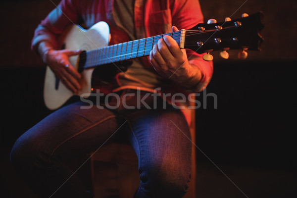 Mid-section of man playing guitar  Stock photo © wavebreak_media