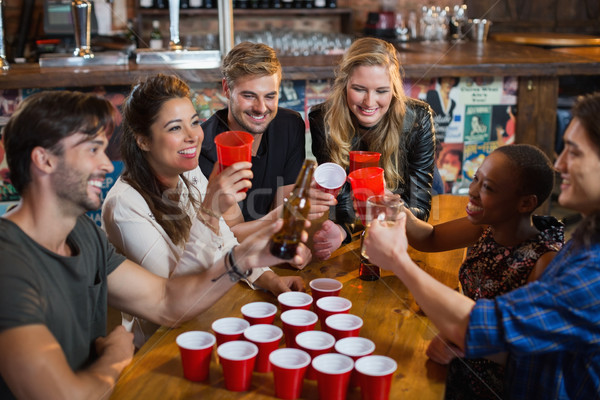 счастливым друзей питьевой пива сидят вокруг Сток-фото © wavebreak_media