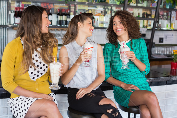 Female friends having drink in restaurant Stock photo © wavebreak_media