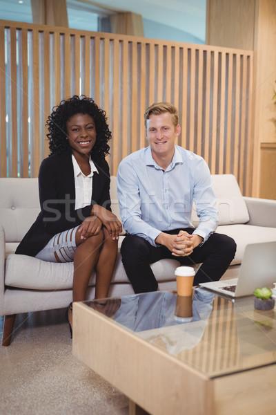 портрет улыбаясь сидят диван служба Сток-фото © wavebreak_media