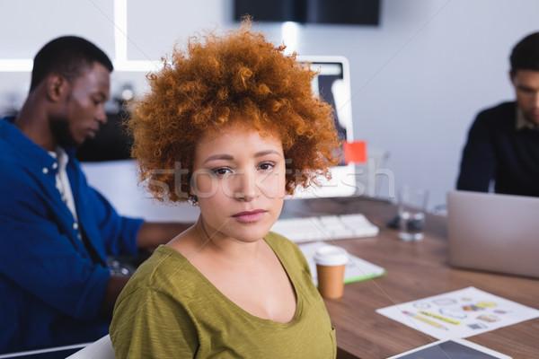 Portrait of businesswoman with colleagues Stock photo © wavebreak_media