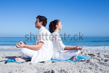 Full length of smiling couple exercising at beach Stock photo © wavebreak_media