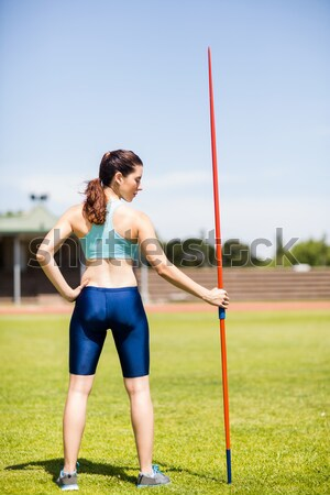Full length of rugby player catching ball against blue sky Stock photo © wavebreak_media