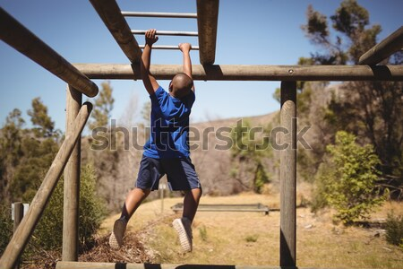 Kids climbing monkey bars during obstacle course training Stock photo © wavebreak_media
