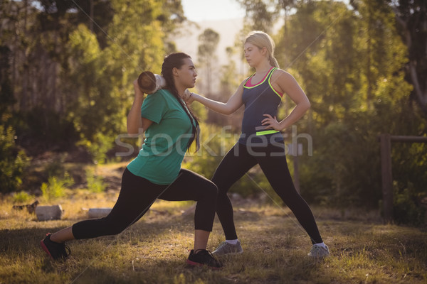 Trainer assisting woman in exercising Stock photo © wavebreak_media