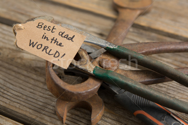 Close up of work tools with greetings on wooden table Stock photo © wavebreak_media