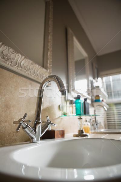 Faucet in sink in empty bathroom Stock photo © wavebreak_media