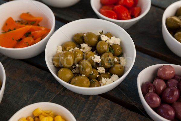 Close up of green olives with cheese by various food Stock photo © wavebreak_media