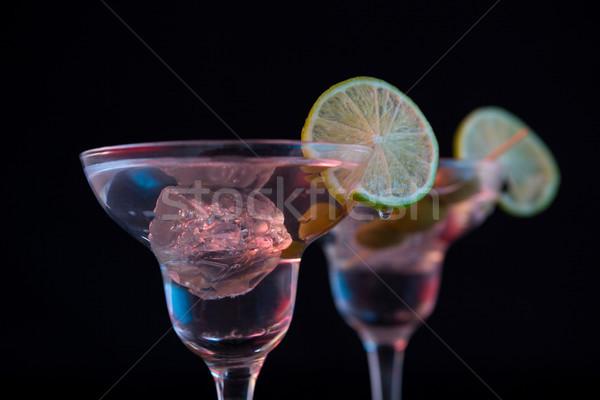 Koktél martini olajbogyók citrus asztal közelkép Stock fotó © wavebreak_media