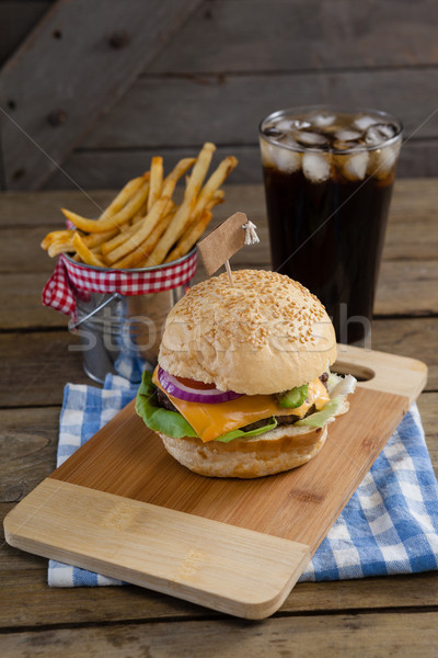 Hamburger, french fries and cold drink on table Stock photo © wavebreak_media