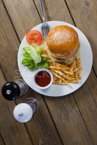 Burger, french fries, sauce in plate on wooden table Stock photo © wavebreak_media