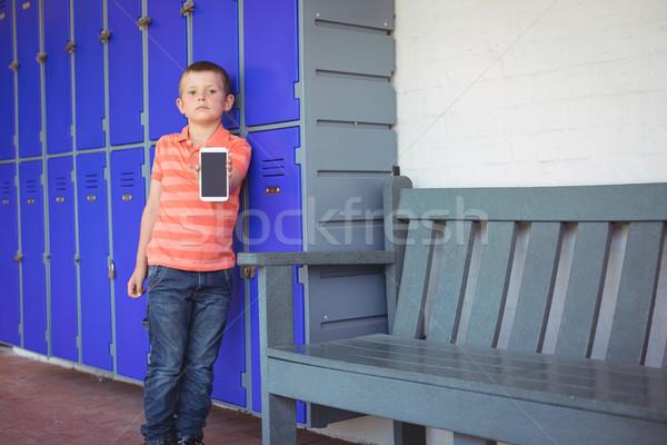 Ritratto ragazzo cellulare corridoio Foto d'archivio © wavebreak_media