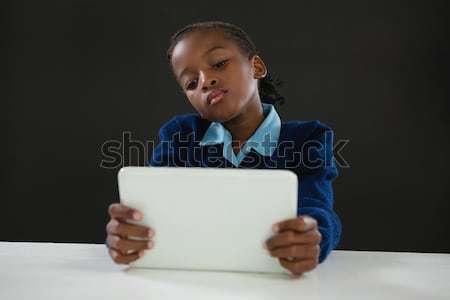 Schoolgirl using digital tablet Stock photo © wavebreak_media