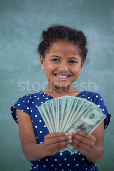Close up portrait of smiling girl showing paper currency Stock photo © wavebreak_media