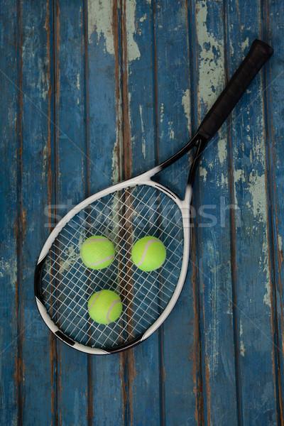 Overhead view of tennis racket and balls Stock photo © wavebreak_media