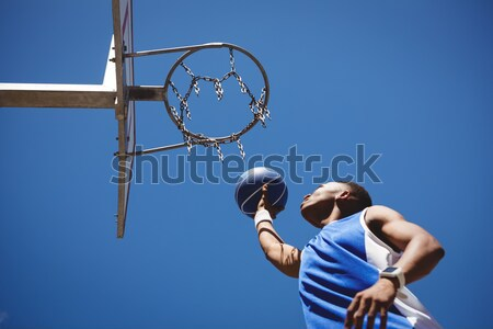 Sportsman with arms outstretched holding rugby ball Stock photo © wavebreak_media